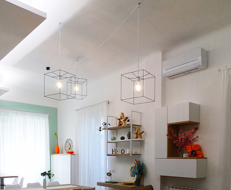INTERIOR DESIGN ZONA LIVING - DETTAGLIO DEI LAMPADARI Seven Project Studio Cucina moderna