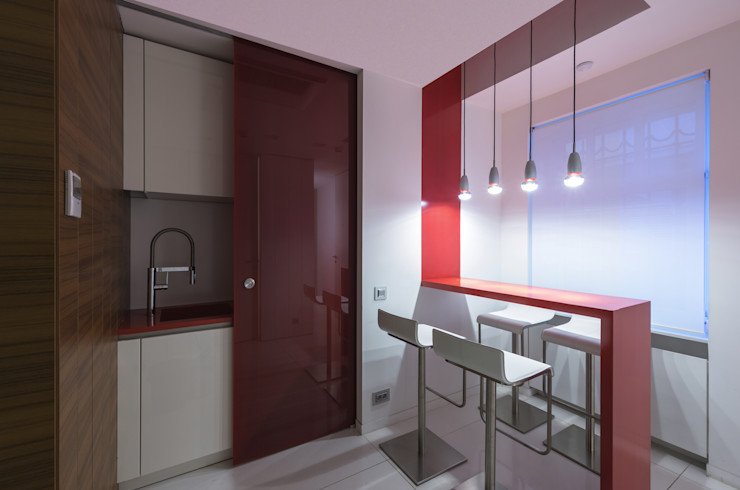 Kitchen furniture in white lacquered structure and red Corian top, Moscow office Tognini Bespoke Furniture KitchenCabinets & shelves Wood Red