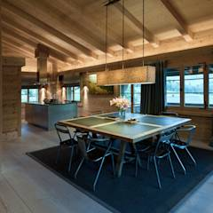 Chalet Gstaad: rustic Dining room by Ardesia Design