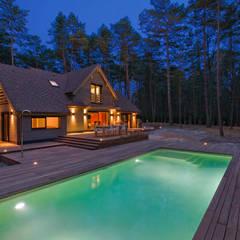 Maison ossature bois: Piscine de style de style Moderne par blackStones