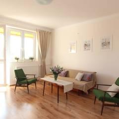SALON PO METAMORFOZIE: styl translation missing: pl.style.salon.skandynawski, w kategorii Salon zaprojektowany przez Better Home
