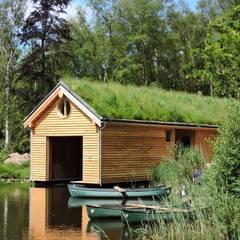 Casas modernas por Organic Roofs