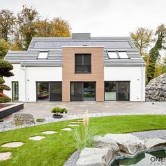 ORT DER RUHE: moderne Häuser von ONE!CONTACT - Planungsbüro
