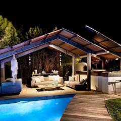 Pool House at Night : mediterranean Pool by TG Studio