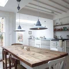 Rear Extension: modern Dining room by Oakman