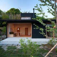 南庭から見た全景: 宇佐美建築設計室が手掛けたtranslation missing: jp.style.家.classic家です。