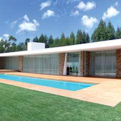 Vista da casa e piscina: Habitações translation missing: pt.style.habitações.moderno por A.As, Arquitectos Associados, Lda