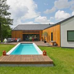 Dom: styl translation missing: pl.style.basen.nowoczesny, w kategorii Basen zaprojektowany przez stando interior design