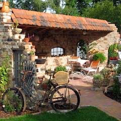Antike Baustoffe: klassischer Garten von Antik-Stein