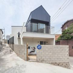 홍제동 개미마을 주택 프로젝트: OBBA 의 translation missing: kr.style.주택.modern 주택