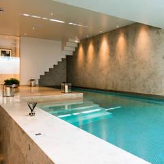 Basement pool at Bedford Gardens house. : modern Pool by Nash Baker Architects Ltd