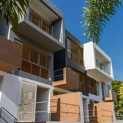 RESIDENCIAS PARQUE VIRGINIA: casas entre luces: Casas de estilo translation missing: ve.style.casas.clasico por NMD NOMADAS