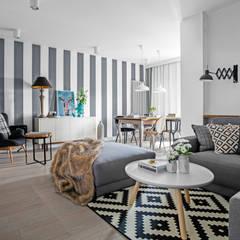 Our photoshoot of apartment design by Domaga Architects : styl translation missing: pl.style.salon.eklektyczny, w kategorii Salon zaprojektowany przez Ayuko Studio