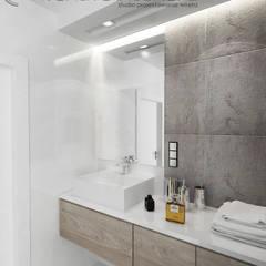 Płytki imitujące beton: styl translation missing: pl.style.Łazienka.minimalistyczny, w kategorii Łazienka zaprojektowany przez Inventive Interiors
