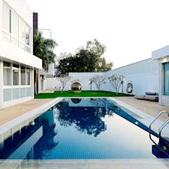 Peacock and the Woods : modern Pool by Aijaz Hakim Architect [AHA]