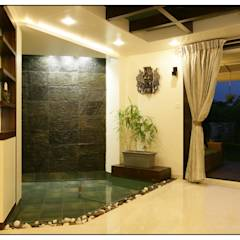 A small water curtain creates a calming effect in the home: modern Pool by Navmiti Designs
