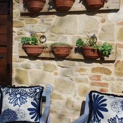Piccolo angolo di Paradiso: Giardino in stile in stile Mediterraneo di Giardini Giordani