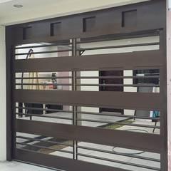 Garages de estilo moderno por Elite Puertas Automaticas