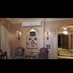 تشطيب وديكور داخلى: translation missing: eg.style.غرفة-المعيشة.modern غرفة المعيشة تنفيذ Royal designs