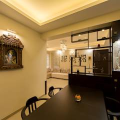 Display Unit along with Puja nook: modern Dining room by Navmiti Designs