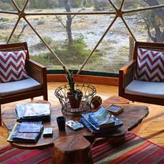 Confort y tranquilidad: Livings de estilo moderno por Angélica Guzmán