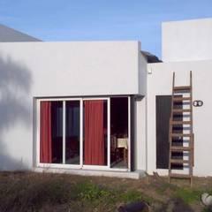 Casa Didi : Casas de estilo translation missing: ve.style.casas.eclectico por Patricio Galland Arquitectura