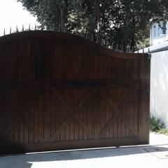 Arched Meranti Sliding Gate : classic Windows & doors by Window + Door Store Cape
