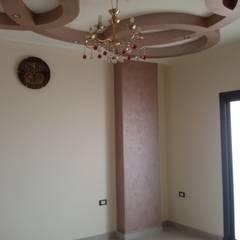 Mr. Hamdy Appartment: translation missing: eg.style.غرفة-المعيشة.classic غرفة المعيشة تنفيذ Etihad Constructio & Decor