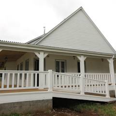 Casa Hott: Casas de estilo rural por Kanda arquitectos