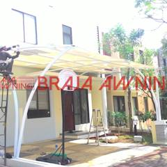 Tenda Membra teras rumah: translation missing: id.style.teras.modern Teras by Braja Awning