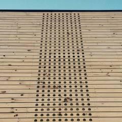 Bodega Rengifo: Oficinas y comercios de estilo translation missing: cl.style.oficinas-y-comercios.rural por Naritelli-Bravo Arquitectos
