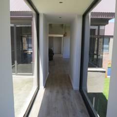 Passage link: rustic Windows & doors by Urban Habitat Architects