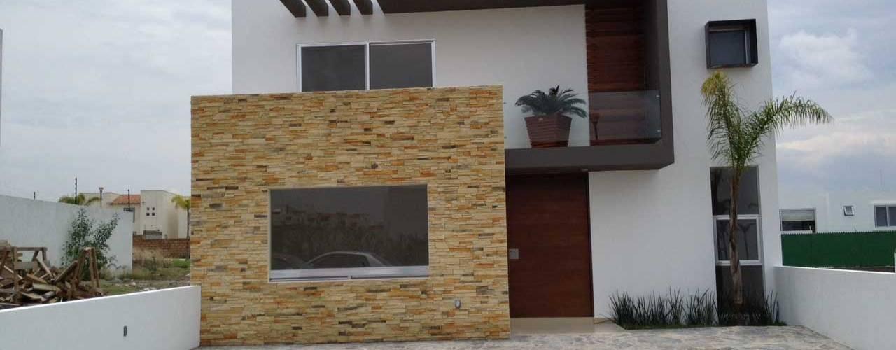 14 casas peque as que te inspirar n a dise ar la tuya for Fachada de casas modernas con porton