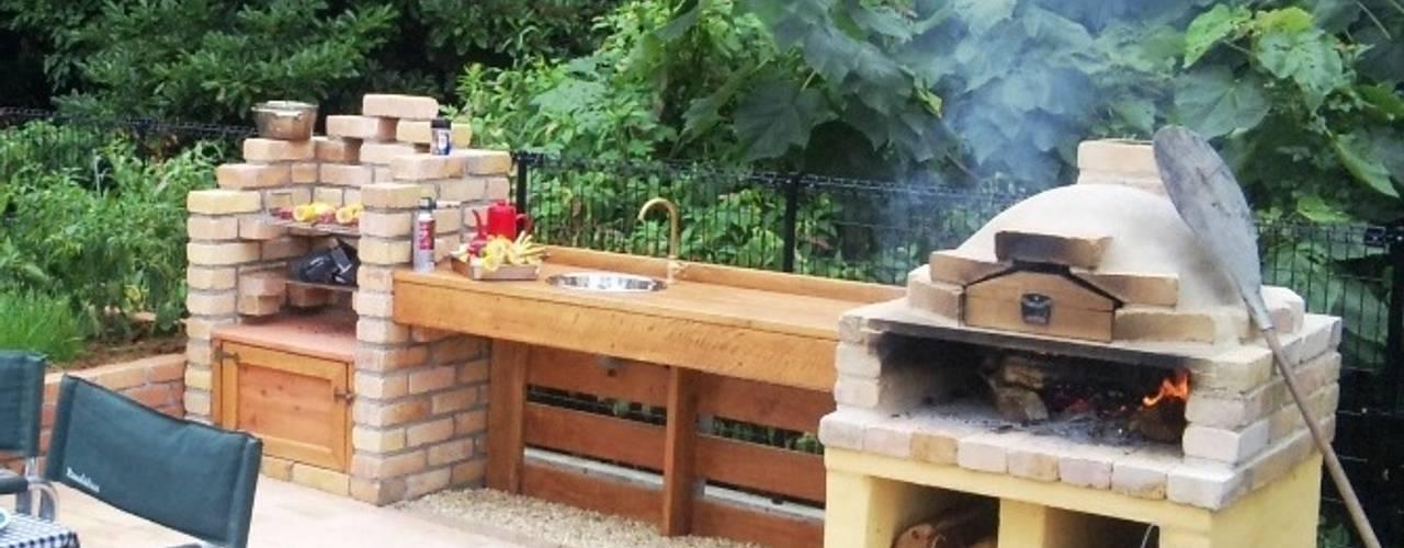 6 pasos para construir un asador de ladrillo en tu patio for Asadores para carne jardin