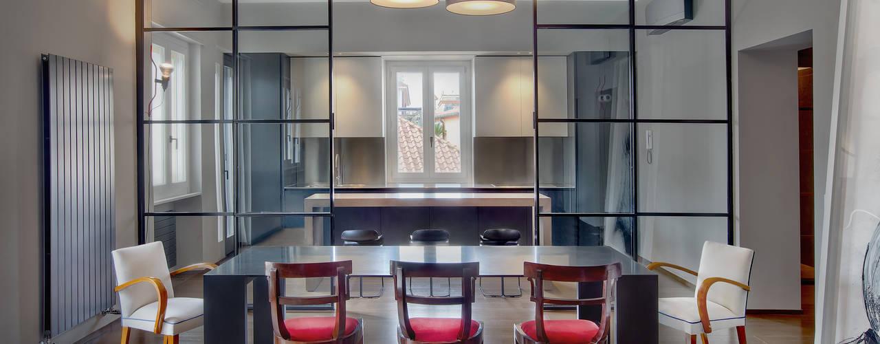 8 modi per dividere il soggiorno dalla cucina for Planimetrie della sala da pranzo della cucina aperta
