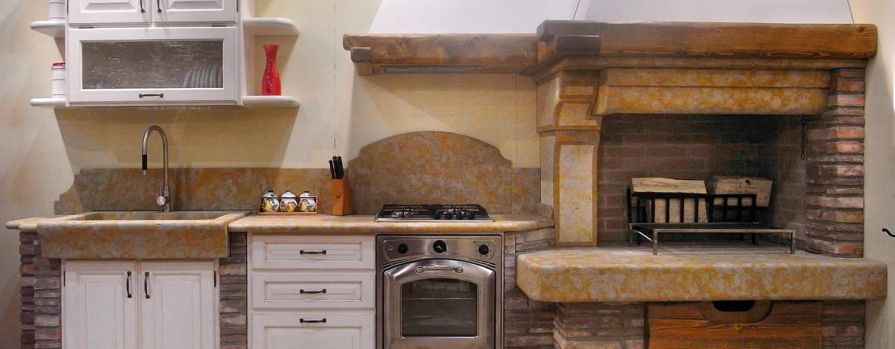 Cocinas de estilo rústico por SALM Caminetti