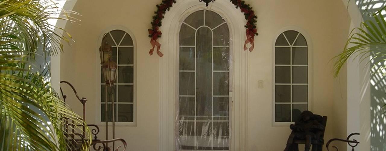 10 dise os de ventanas que har n lucir tu fachada - Arcos decorativos para puertas ...