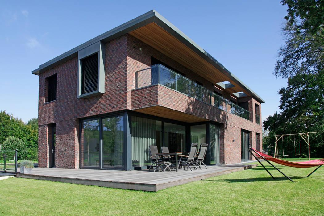 Fotos de casas de estilo moderno de archstudio architecten villa 39 s en interieur homify - Foto gevel moderne villa ...