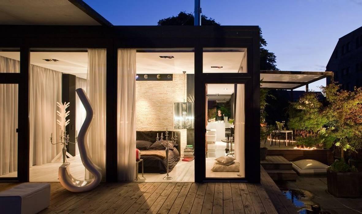 foto di camera da letto in stile in stile moderno di. Black Bedroom Furniture Sets. Home Design Ideas