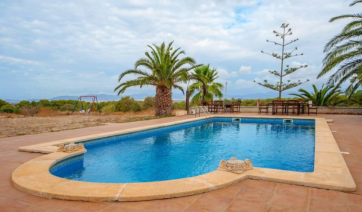 Fotos de piscinas de estilo colonial villa s 39 aranjassa for Estilos de piscinas