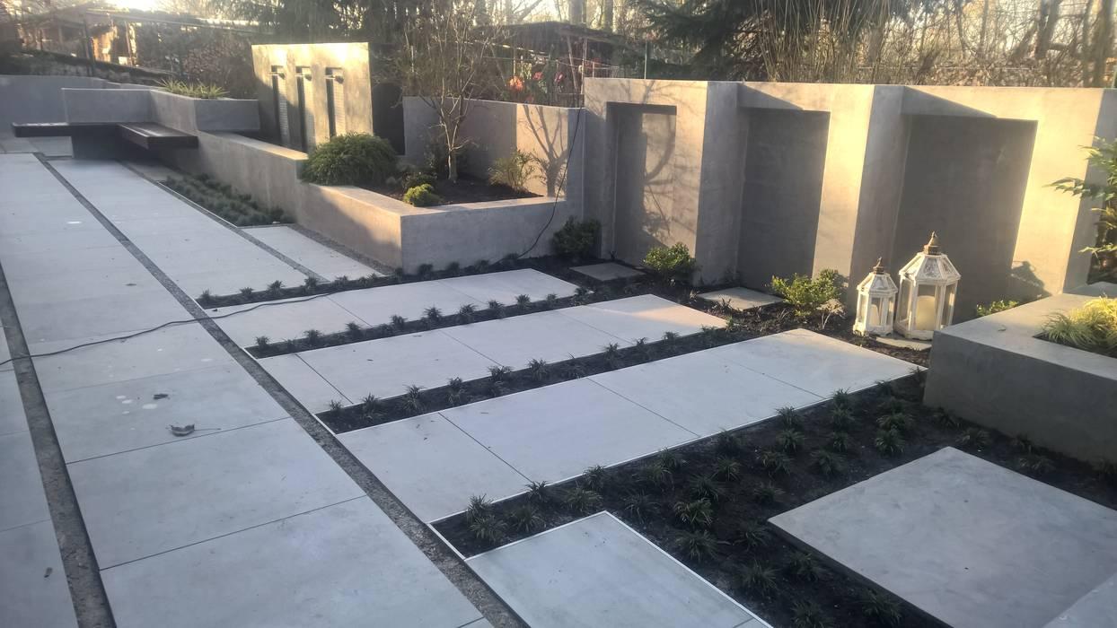 Moderne terrasse mit wasserfall sitzbank und treppenstufen moderner garten von neues gartendesign by wentzel