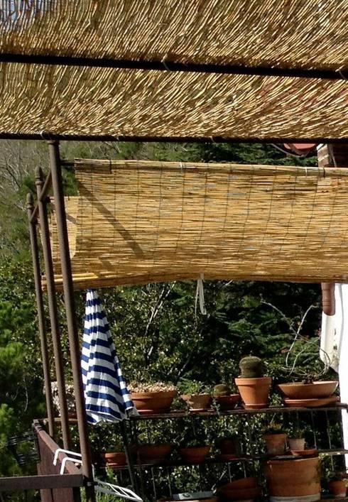 Il terrazzo con rivestimenti in bamb for Pergolato con canne di bambu