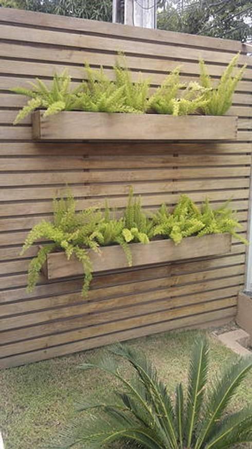 7 sencillas ideas con madera para tener un jard n for Jardines pequenos horizontales