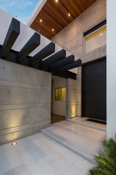 8 ideas con piedra para modernizar las paredes de tu casa for Modernizar fachada casa
