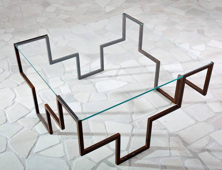 Iron age la nuova era dei tavoli in ferro battuto - Tavolo ferro battuto e vetro ...