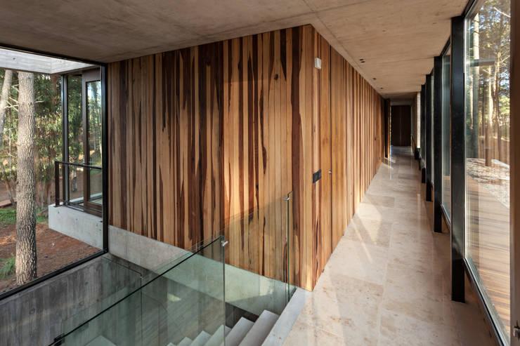 modern Walls & floors by ATV Arquitectos