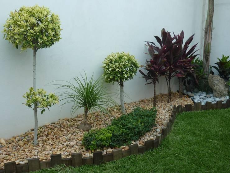 15 dise os de jardineras que dar n un cambio radical a tu - Disenos de jardines con piedras blancas ...