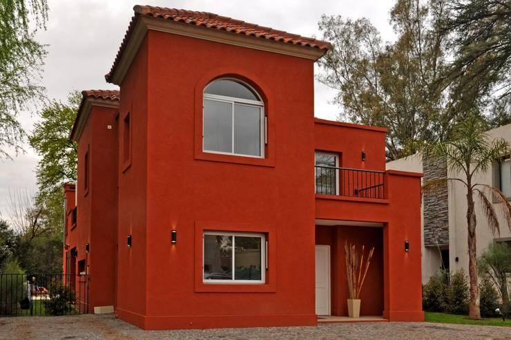 8 formas de dar color a la fachada de tu casa for Color fachada casa