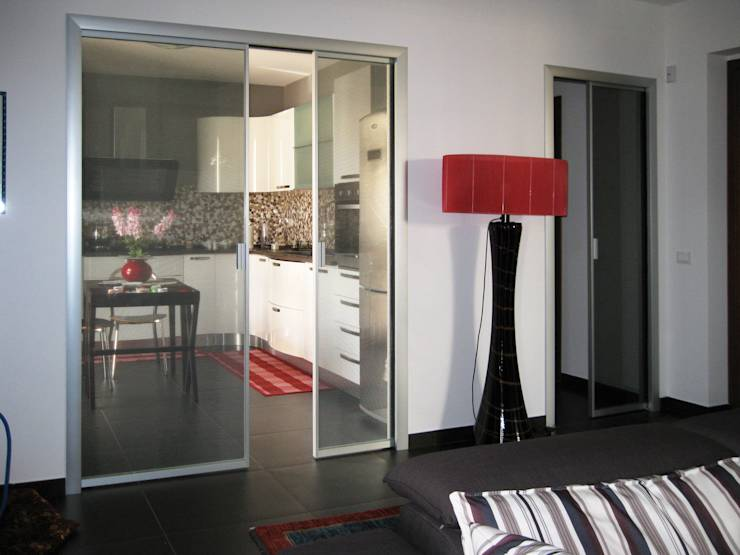 Come separare la cucina dal soggiorno senza controindicazioni for Porte per dividere ambienti