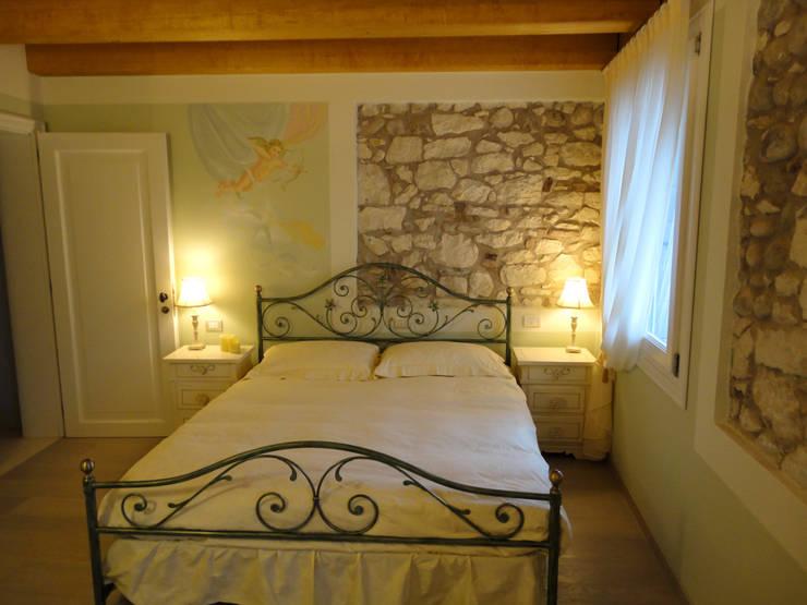 I letti matrimoniali in ferro battuto romantici con stile for Come progettare un appartamento con una camera da letto